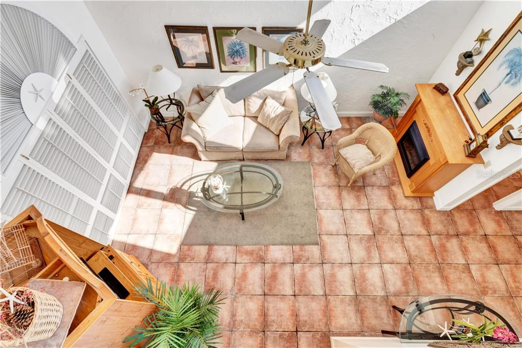 The view from the 2nd story stairwell. The fireplace is a moveable piece of furniture and has an electric heater inside for those chilly mornings. - Single Family Home for sale at 5214 S Riverview Cir, Homosassa, FL 34448 - MLS Number is A4414387