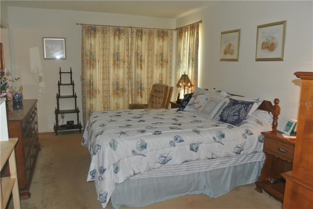 Master Bedroom with private screened lanai - Single Family Home for sale at 111 55th St Nw, Bradenton, FL 34209 - MLS Number is A4414676