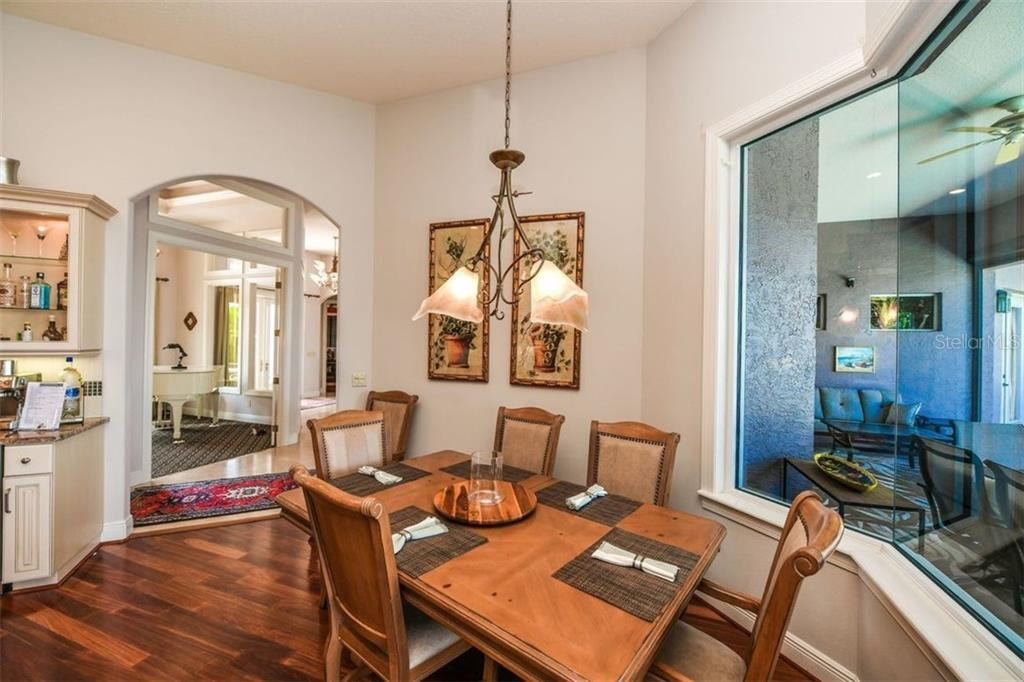 Casual dining with water views. - Single Family Home for sale at 1483 Tangier Way, Sarasota, FL 34239 - MLS Number is A4414757