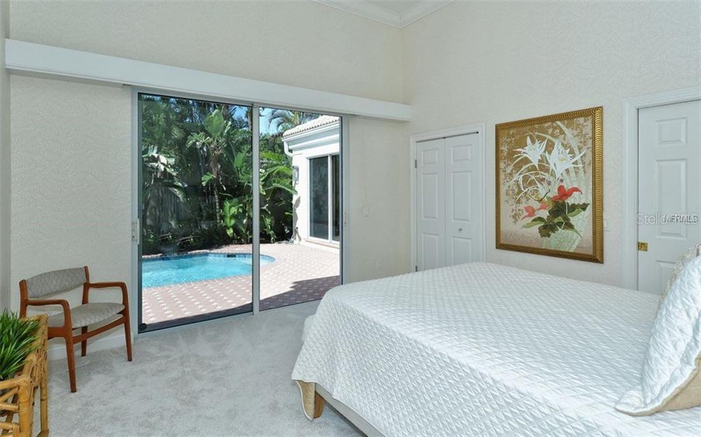 This 2nd bedroom on the first floor with private bath and walk-in closet has direct access to the courtyard pool - Single Family Home for sale at 3529 Fair Oaks Ln, Longboat Key, FL 34228 - MLS Number is A4414992