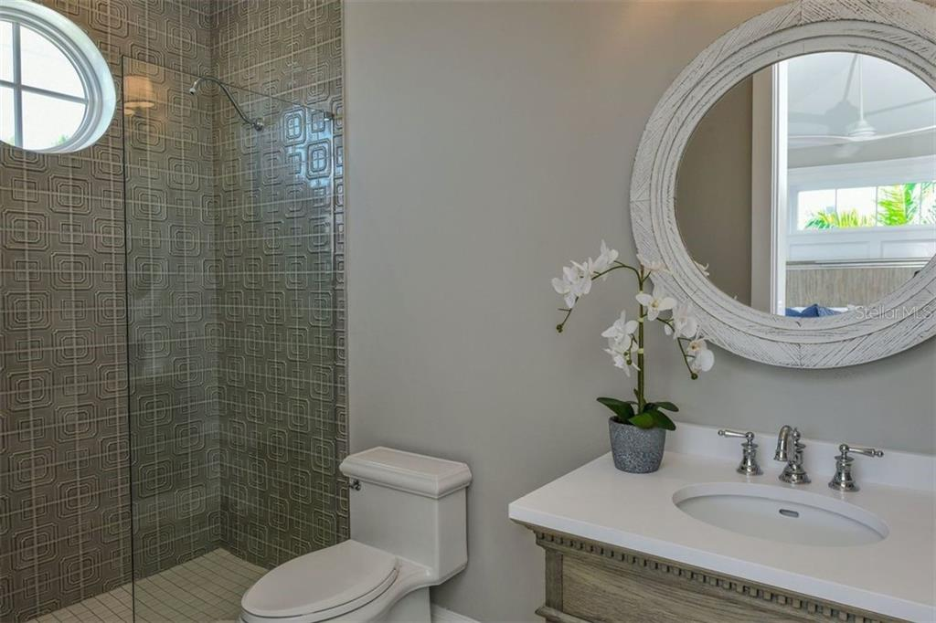Bathroom 5 on level 3. - Single Family Home for sale at 3470 Gulf Of Mexico Dr, Longboat Key, FL 34228 - MLS Number is A4415298