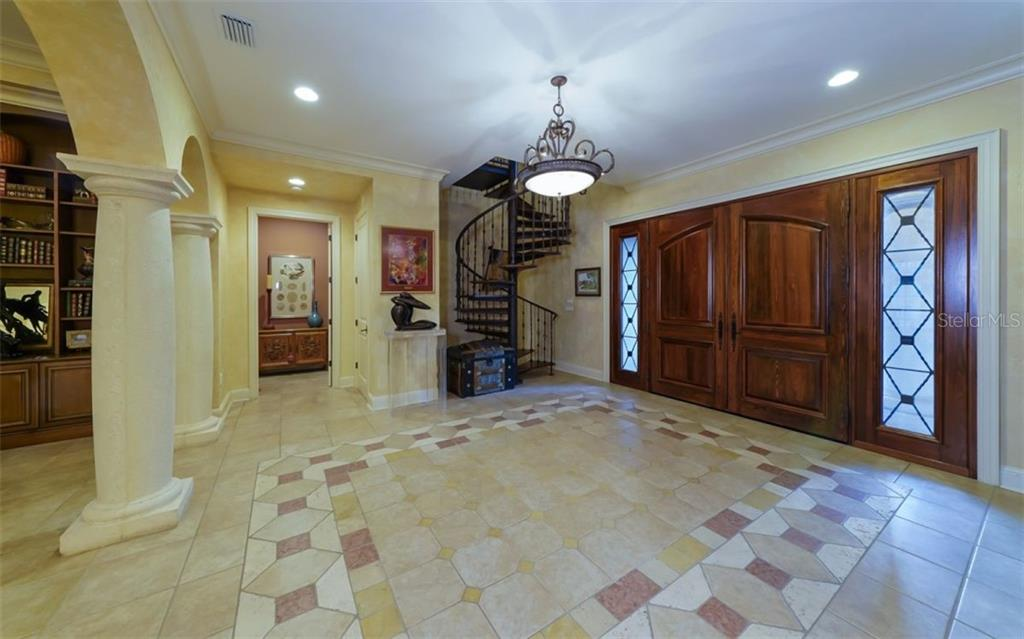 Grand Foyer - Custom Stairs to Loft - Single Family Home for sale at 2829 Wilfred Reid Cir, Sarasota, FL 34240 - MLS Number is A4416091