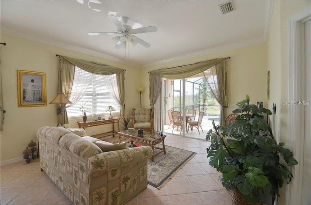 Sitting area overlooking pool and 14th tee. - Villa for sale at 252 Fairway Isles Ln, Bradenton, FL 34212 - MLS Number is A4417217