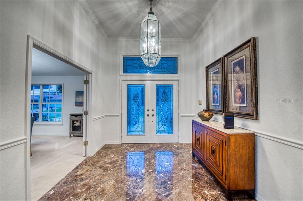 Welcoming foyer in Marble, double door entry doors. - Single Family Home for sale at 7689 Cove Ter, Sarasota, FL 34231 - MLS Number is A4417242