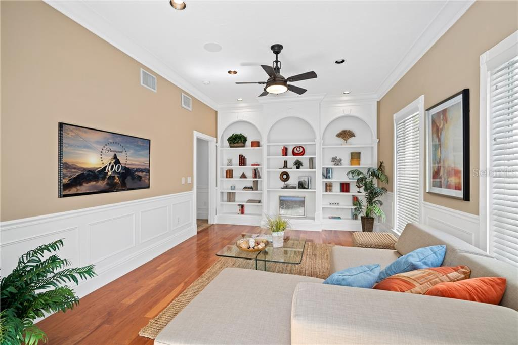 Library/Bonus Room with stunning built-in display shelves and glass-paneled French doors to back garden. - Single Family Home for sale at 1654 Landings Blvd, Sarasota, FL 34231 - MLS Number is A4417765