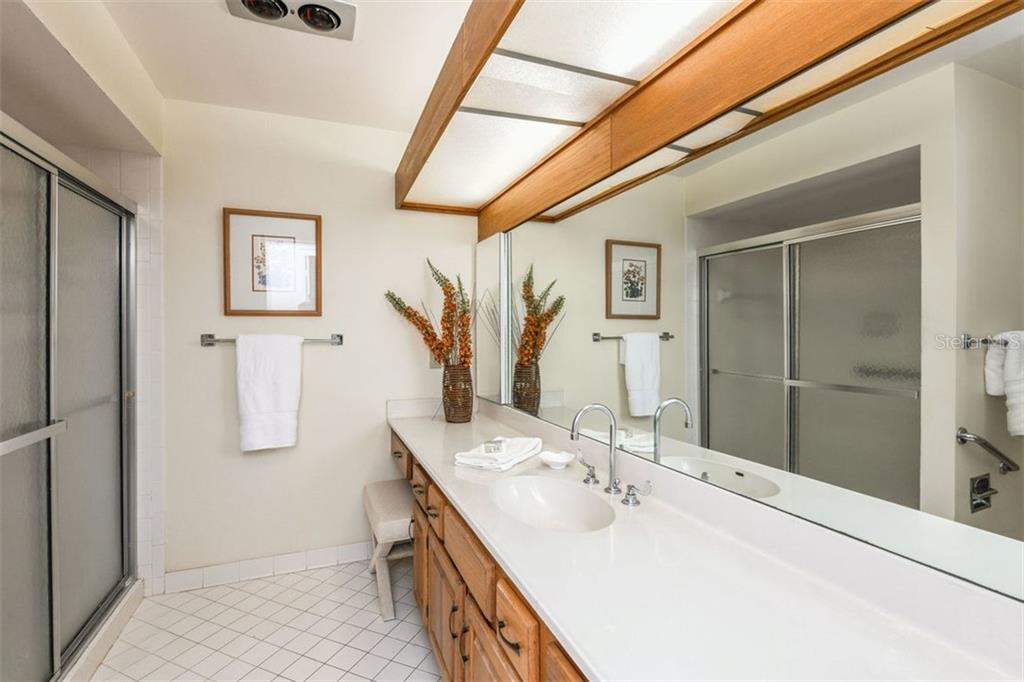 Master bathroom with walk in shower. Plenty of room to add a second sink if desired. - Villa for sale at 3617 Gleneagle Dr, Sarasota, FL 34238 - MLS Number is A4417832