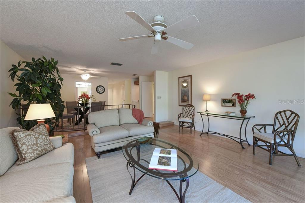 Open plan with combined living and dining rooms. - Villa for sale at 3617 Gleneagle Dr, Sarasota, FL 34238 - MLS Number is A4417832