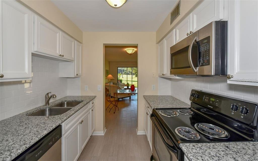 Beautifully updated Kitchen - Condo for sale at 4576 Longwater Chase #59, Sarasota, FL 34235 - MLS Number is A4418168