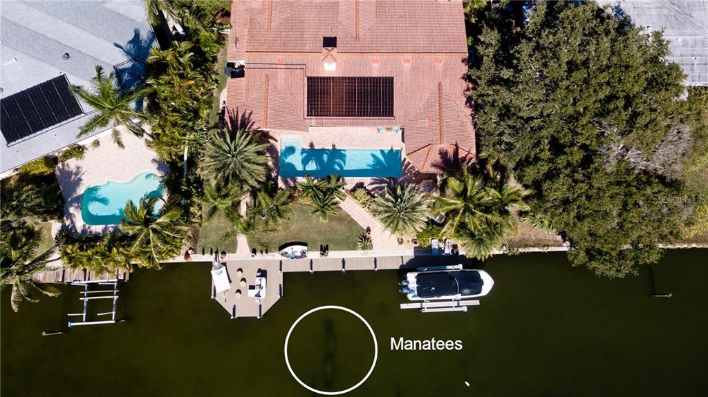 Manatees - Single Family Home for sale at 612 Ambassador Ln, Holmes Beach, FL 34217 - MLS Number is A4418766