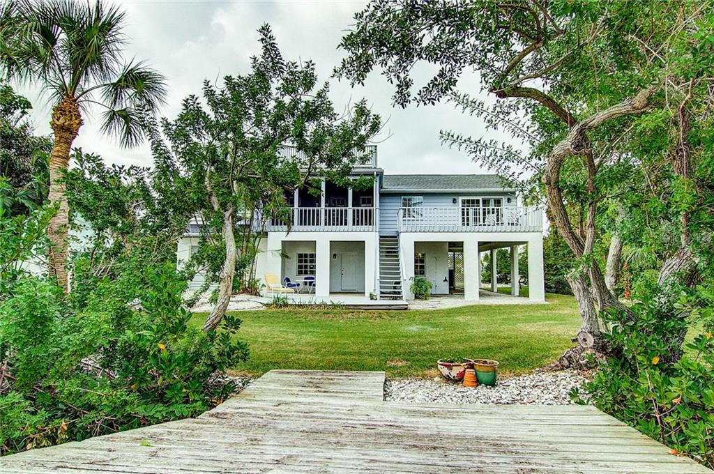 Back view from the dock - Single Family Home for sale at 521 75th St, Holmes Beach, FL 34217 - MLS Number is A4420243