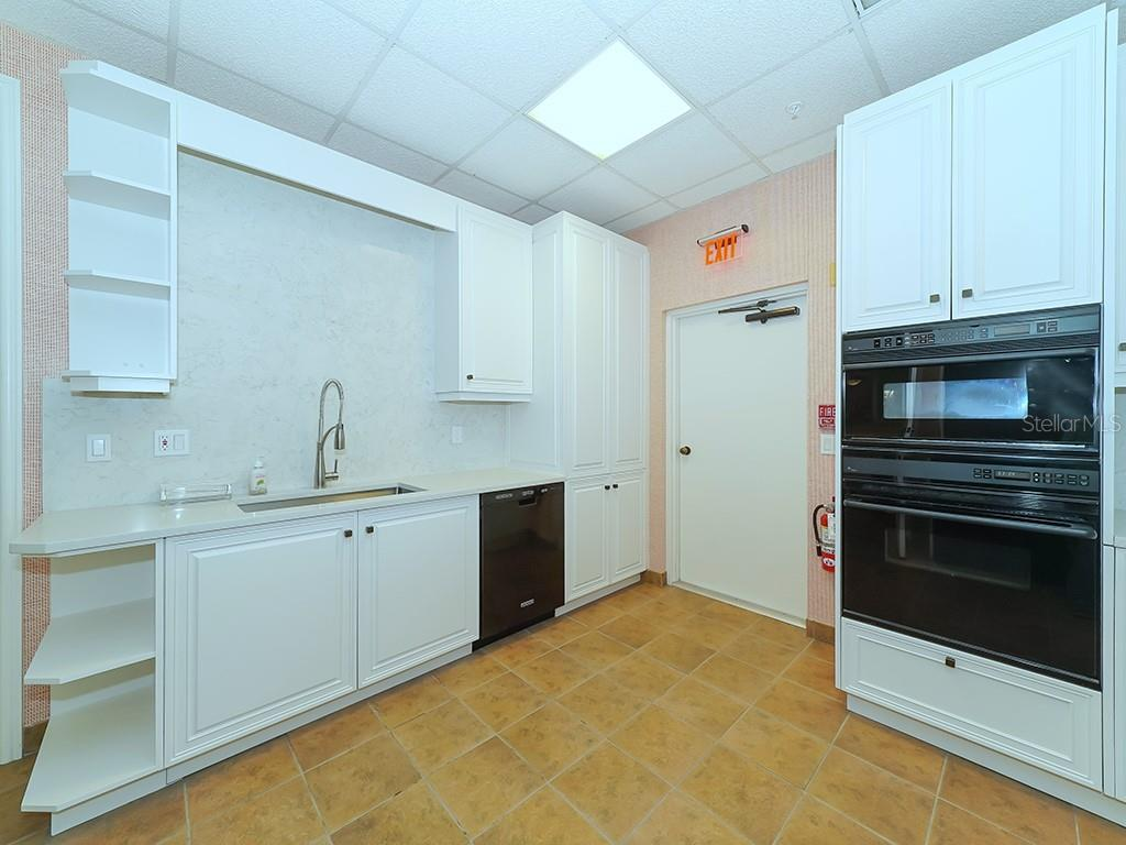 Vizcaya Clubhouse Kitchen - Condo for sale at 2399 Gulf Of Mexico Dr #3c3, Longboat Key, FL 34228 - MLS Number is A4421722