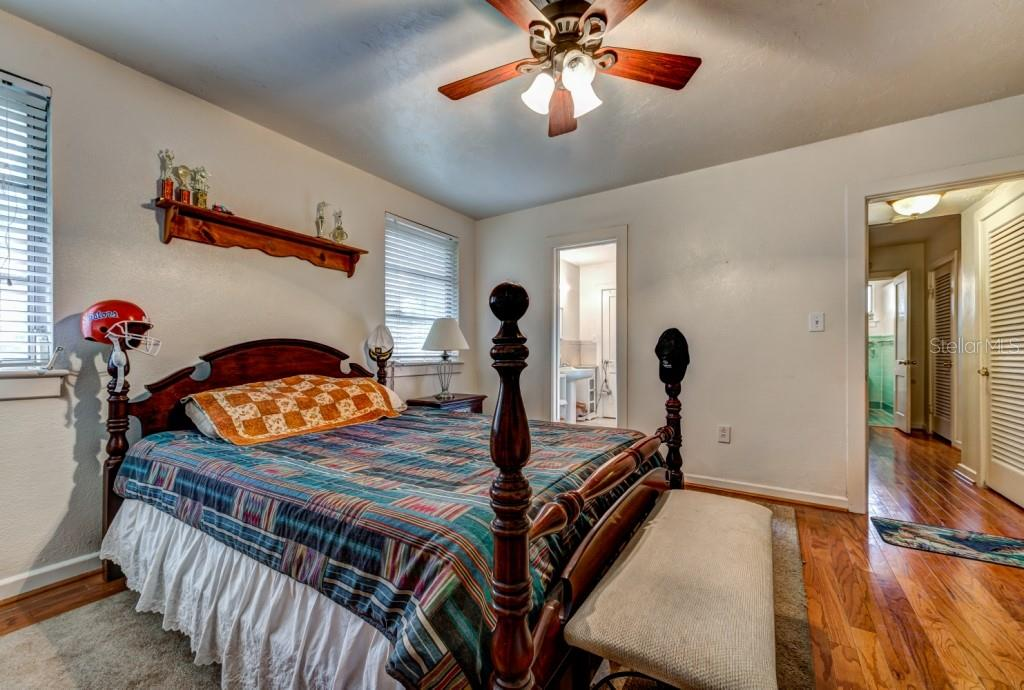 Bedroom two has a Jack & Jill bathroom that can be accessed from the third bedroom as well. It features a pedestal sink and its own walk-in shower. - Single Family Home for sale at 1509 Flower Dr, Sarasota, FL 34239 - MLS Number is A4421898