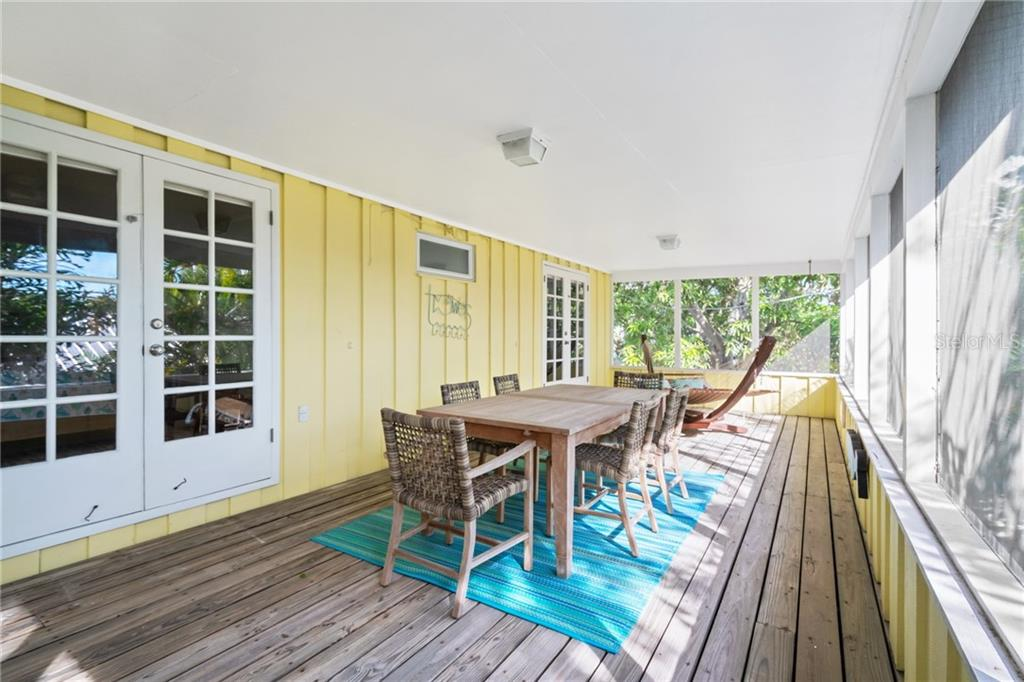 Second Floor Screened In Back Lanai with Dining - Single Family Home for sale at 107 Willow Ave, Anna Maria, FL 34216 - MLS Number is A4421946