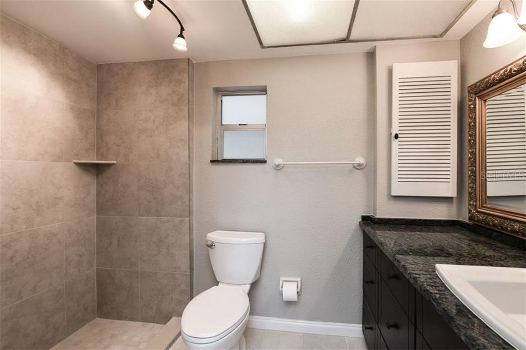 Master bath. - Villa for sale at 3434 Medford Ln #1110, Sarasota, FL 34239 - MLS Number is A4422897
