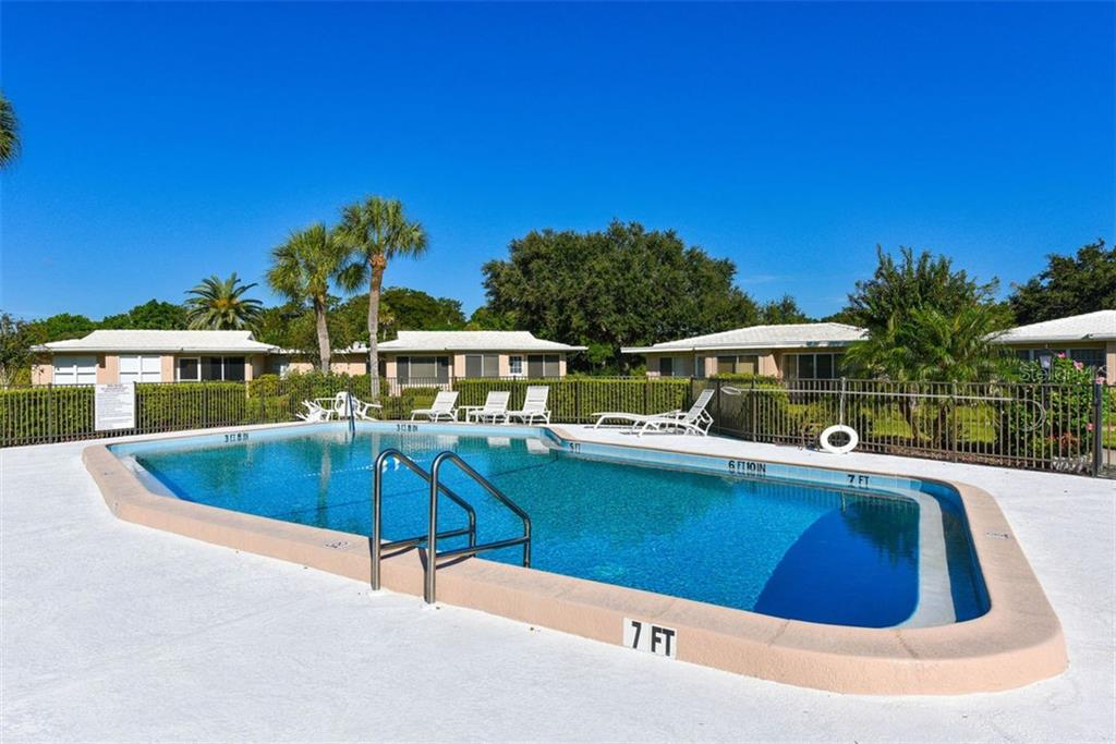 Community pool. - Villa for sale at 3434 Medford Ln #1110, Sarasota, FL 34239 - MLS Number is A4422897