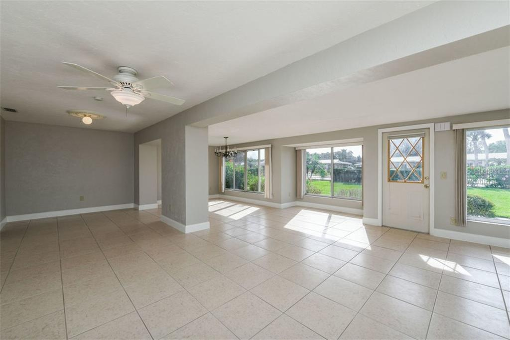 Living room, dining room and bonus room area. - Villa for sale at 3434 Medford Ln #1110, Sarasota, FL 34239 - MLS Number is A4422897