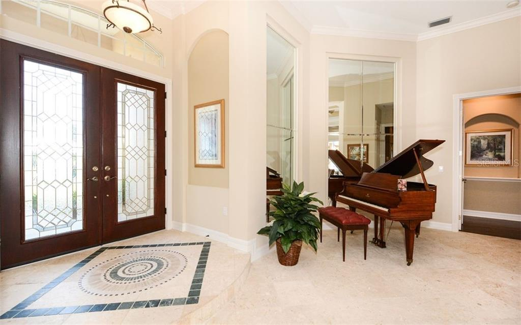 Stunning double door entry and decorative tile inlay - Single Family Home for sale at 2522 Tom Morris Dr, Sarasota, FL 34240 - MLS Number is A4423908