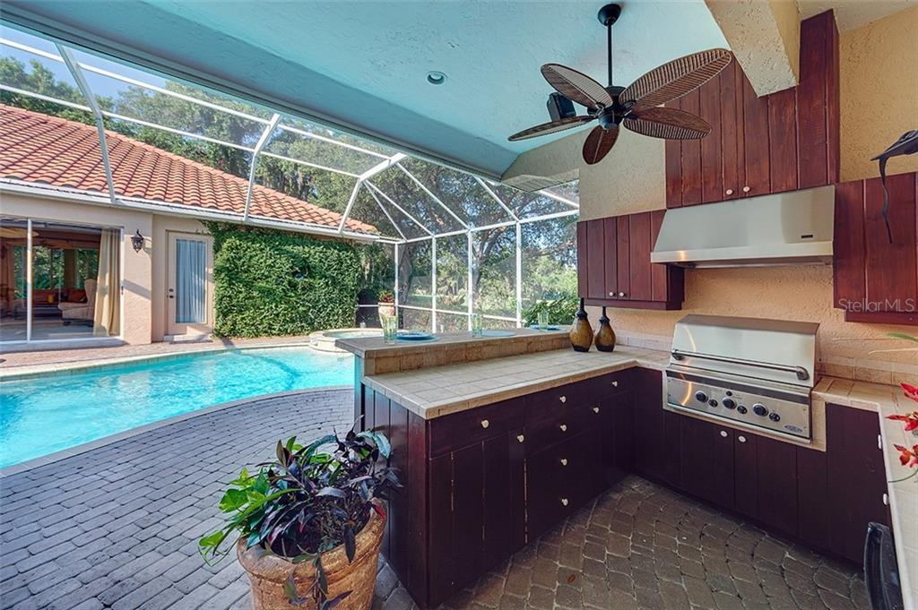 Outdoor kitchen in the courtyard pool area. - Single Family Home for sale at 2972 Jeff Myers Cir, Sarasota, FL 34240 - MLS Number is A4424133
