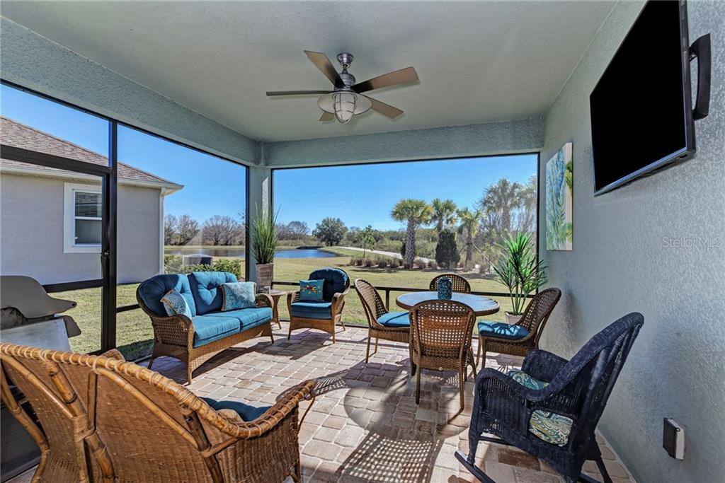 The spacious enclosed porch is perfect for the crisp mornings and perfect Florida evenings! All overlooking the pond, nature trail, and preserve! - Single Family Home for sale at 5260 Bentgrass Way, Bradenton, FL 34211 - MLS Number is A4424484