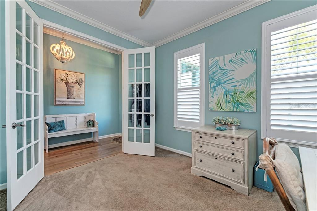 Beautiful French doors open up to a spacious Den, office, or possible 5th bedroom! - Single Family Home for sale at 5260 Bentgrass Way, Bradenton, FL 34211 - MLS Number is A4424484