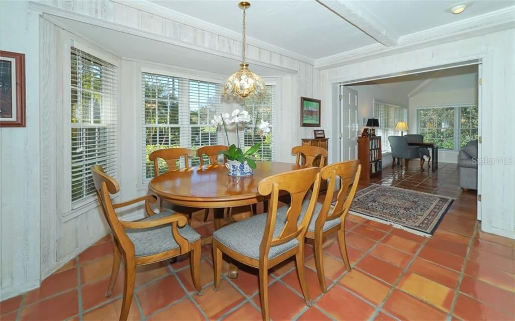 Casual dining area adjacent to the family room - Single Family Home for sale at 510 63rd St Nw, Bradenton, FL 34209 - MLS Number is A4424601