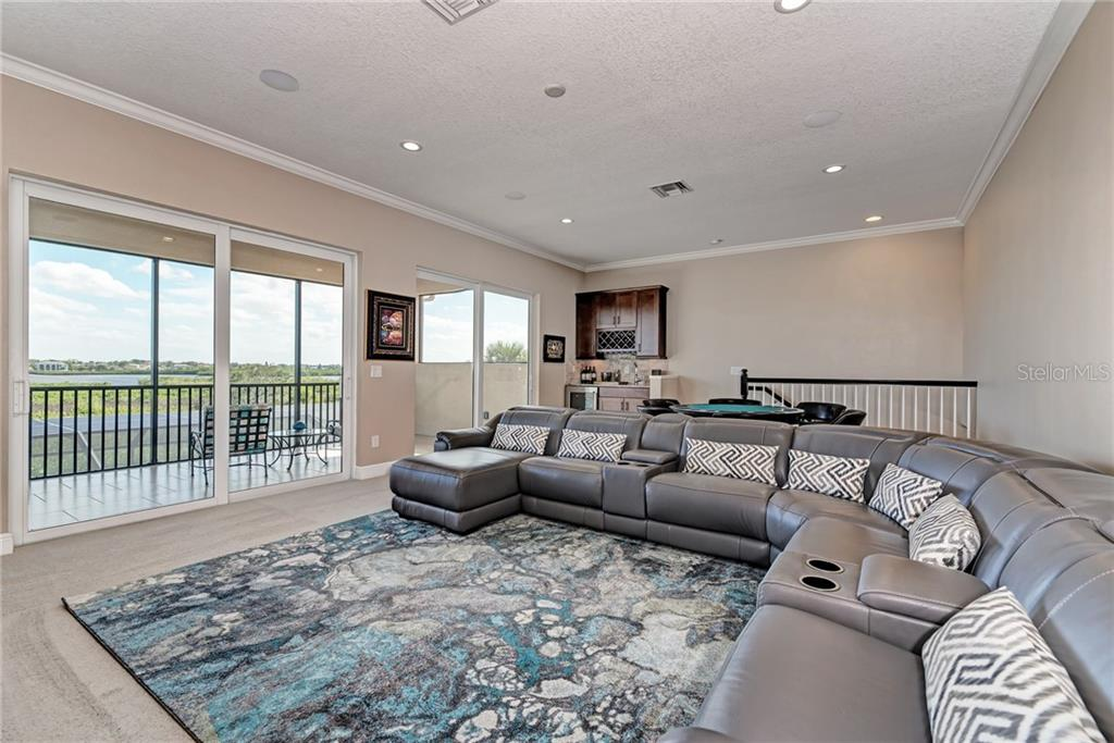 Media/entertainment area with water view - Single Family Home for sale at 5712 Tidewater Preserve Blvd, Bradenton, FL 34208 - MLS Number is A4424693