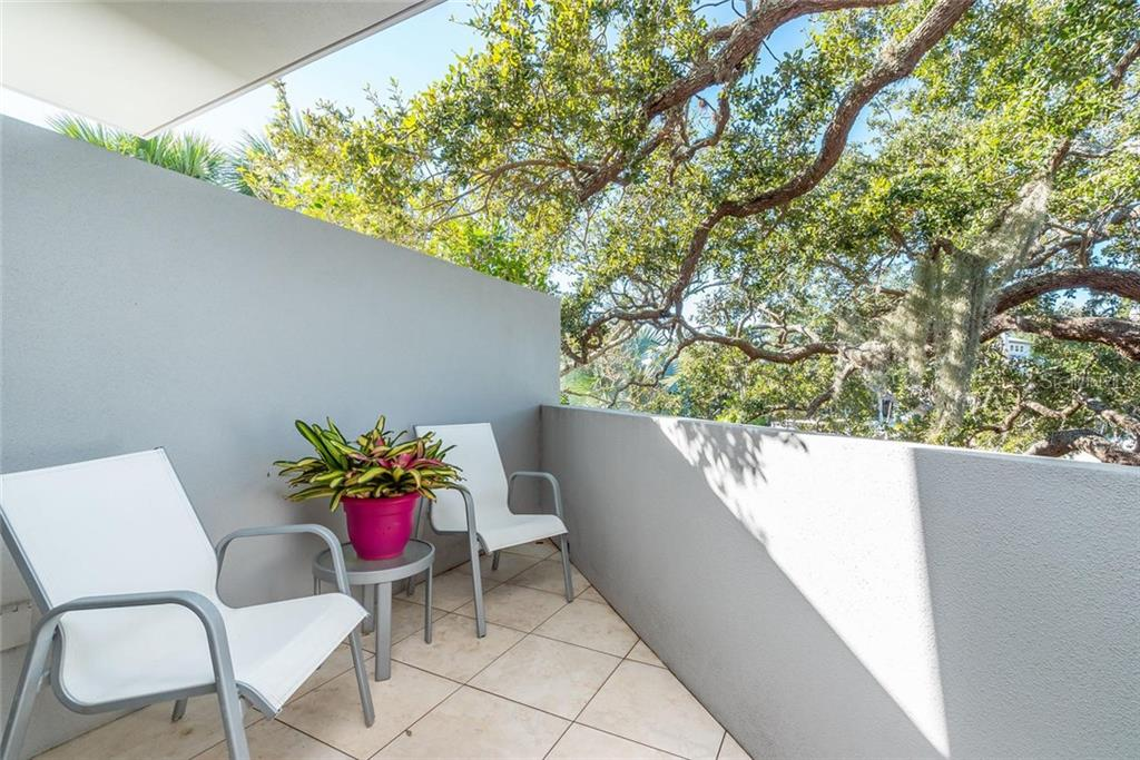 Private, Open Balcony off the Master suite feels like it rests right in the palm of the Majestic Oak overlooking the waterway. - Single Family Home for sale at 509 Venice Ln, Sarasota, FL 34242 - MLS Number is A4425092