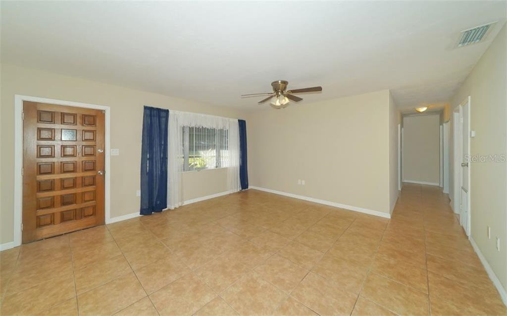 Living Room - Single Family Home for sale at 2451 Wisteria St, Sarasota, FL 34239 - MLS Number is A4427390