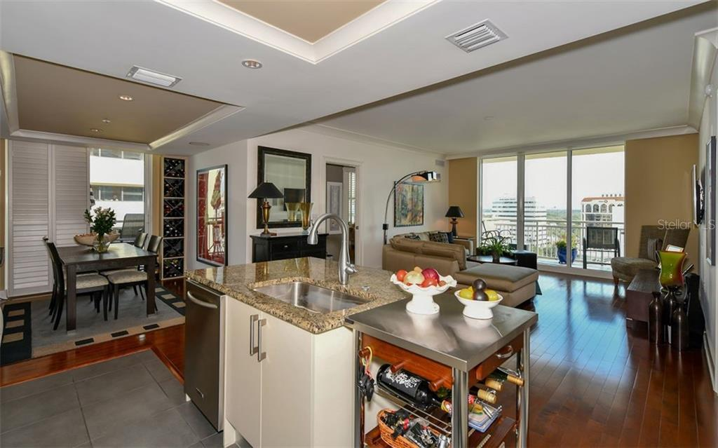 The cosy dining room is a private space - Condo for sale at 1350 Main St #1201, Sarasota, FL 34236 - MLS Number is A4427507