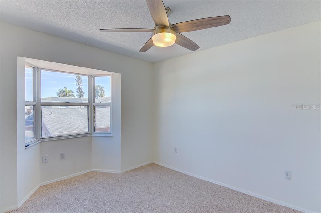 Bedroom on 2nd floor with kitchen and living areas - Condo for sale at 773 Benjamin Franklin Dr #7, Sarasota, FL 34236 - MLS Number is A4427752