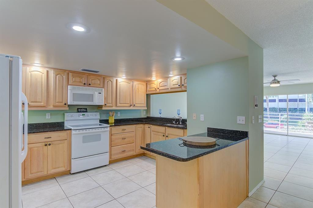 Open kitchen with granite counters - Condo for sale at 773 Benjamin Franklin Dr #7, Sarasota, FL 34236 - MLS Number is A4427752