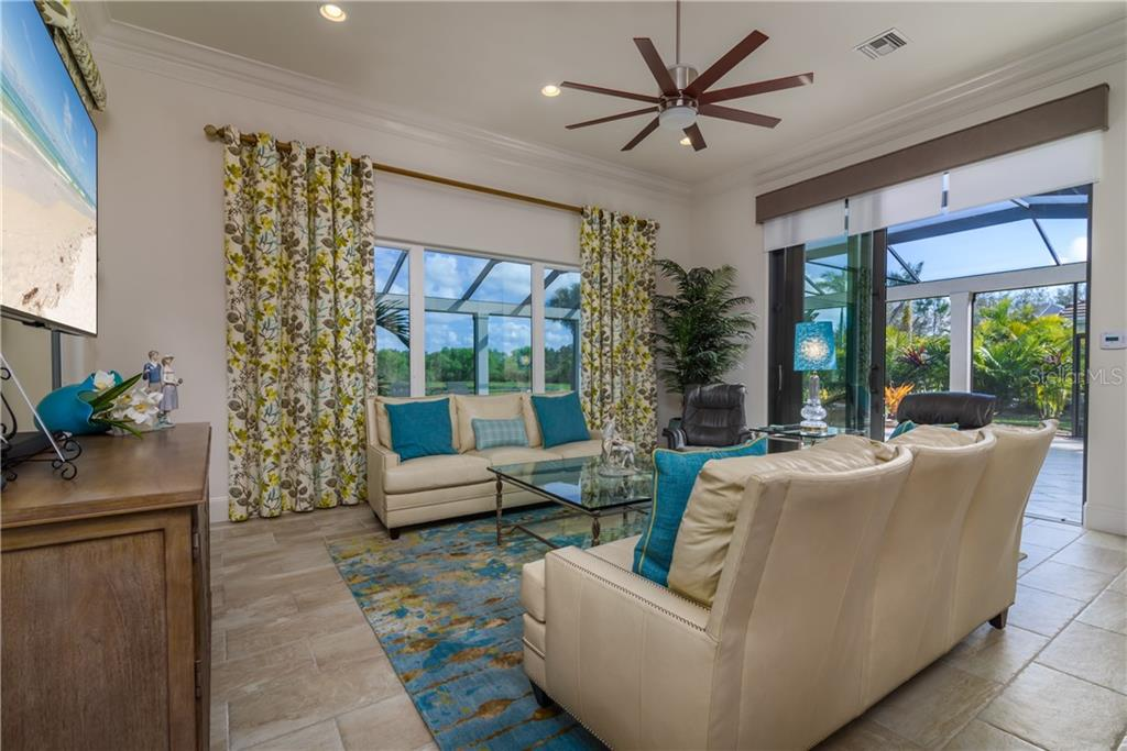 Family Room - Single Family Home for sale at 3507 Founders Club Dr, Sarasota, FL 34240 - MLS Number is A4428010