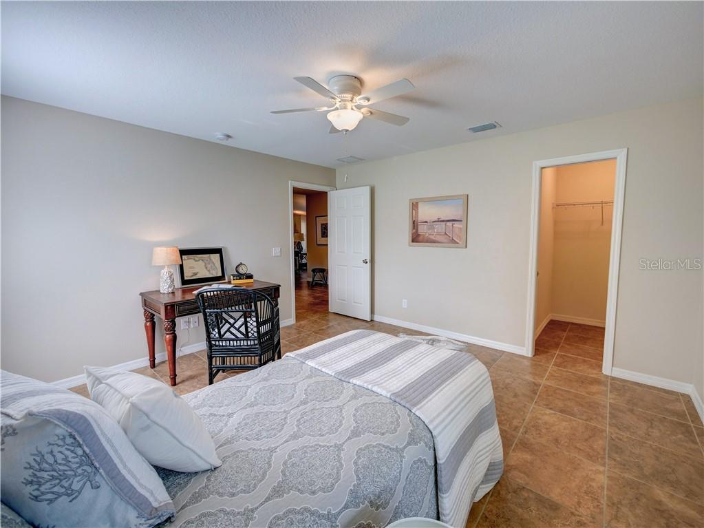 Bedroom 2 closet - Single Family Home for sale at 2558 Oneida Rd, Venice, FL 34293 - MLS Number is A4428145
