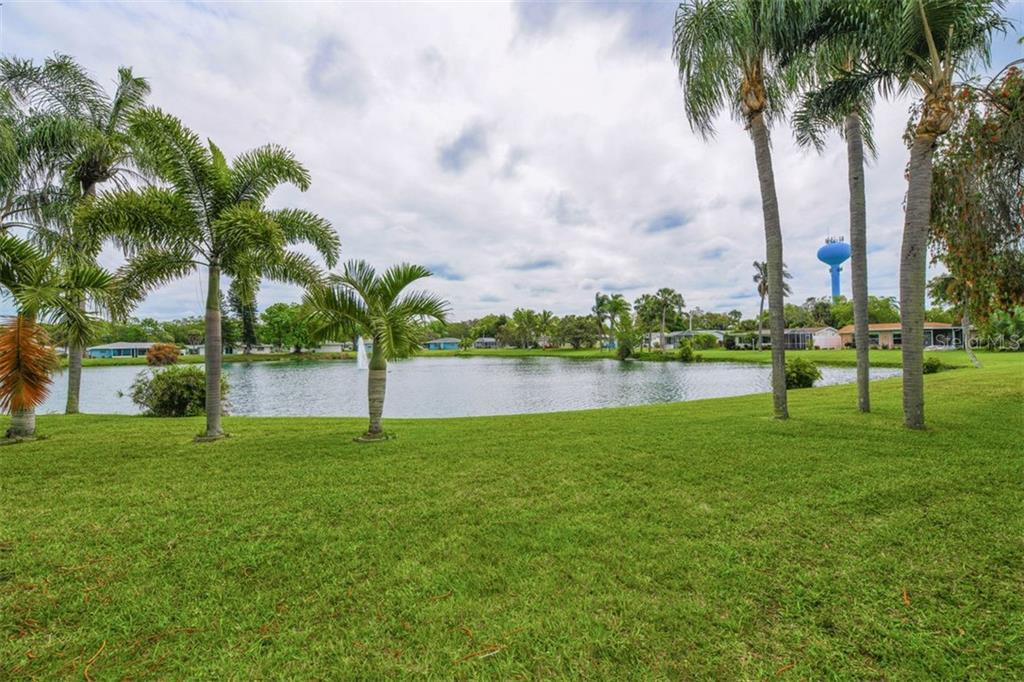 Lake View from Backyard - Single Family Home for sale at 2424 Terry Ln, Sarasota, FL 34231 - MLS Number is A4429030