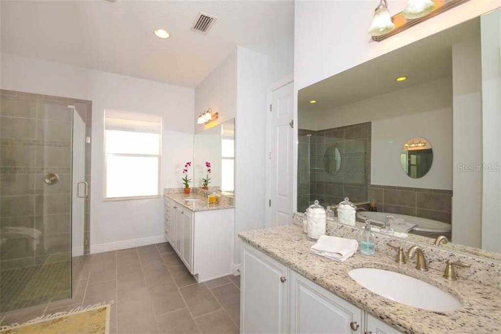 Master bathroom with separate granite topped vanities - Single Family Home for sale at 5504 Tidewater Preserve Blvd, Bradenton, FL 34208 - MLS Number is A4429479