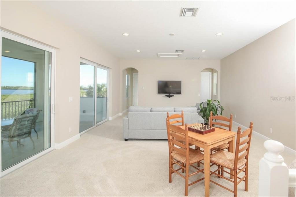Great space and views in the bonus/media room upstairs - Single Family Home for sale at 5504 Tidewater Preserve Blvd, Bradenton, FL 34208 - MLS Number is A4429479