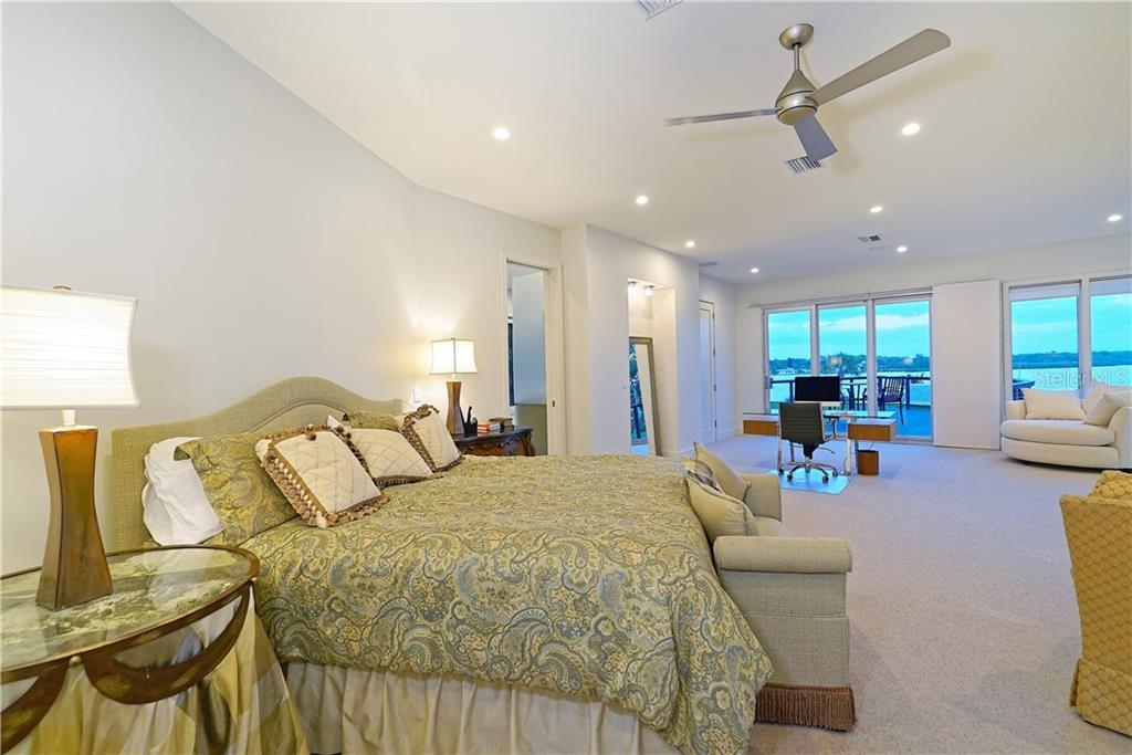 Master bedroom with views of the bay. - Single Family Home for sale at 6841 Peacock Rd, Sarasota, FL 34242 - MLS Number is A4430828