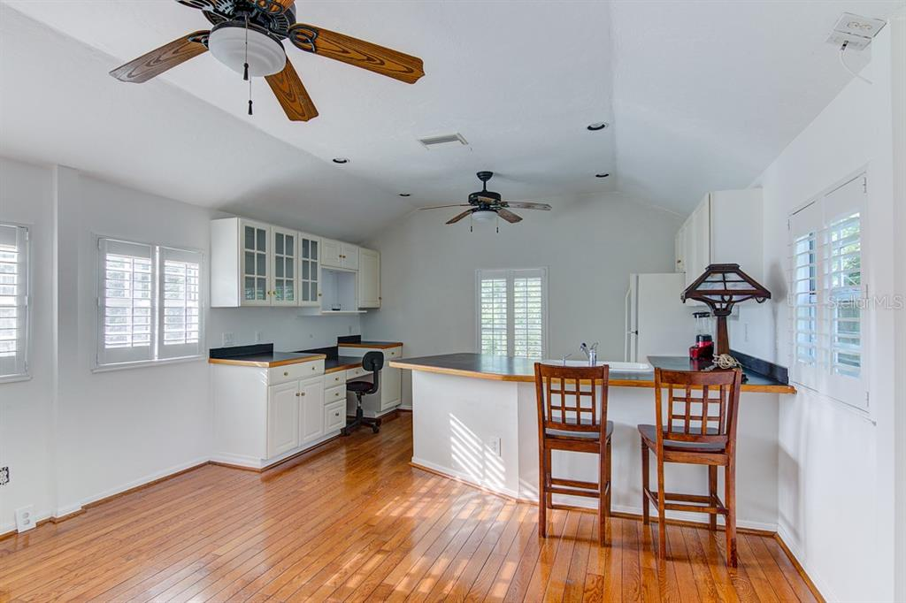 Lots of uses for the upstairs 1 BR apartment - office/man cave/studio/teenager hangout... - Single Family Home for sale at 7945 Palmer Blvd, Sarasota, FL 34240 - MLS Number is A4431318