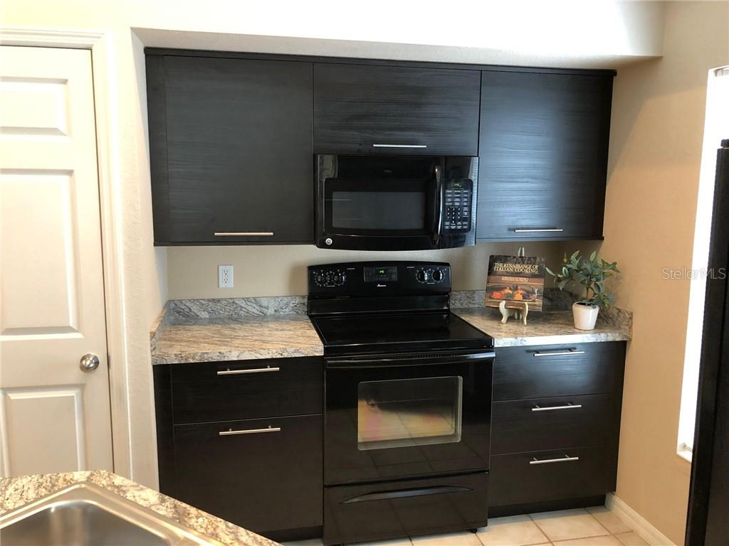 Updated Kitchen w/Lots of Storage - Condo for sale at 5511 Rosehill Rd #201, Sarasota, FL 34233 - MLS Number is A4431621