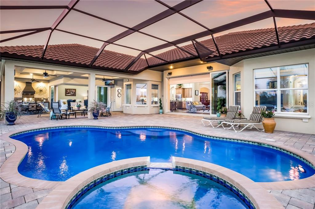 Full view of saltwater pool and spa. - Single Family Home for sale at 19432 Newlane Pl, Bradenton, FL 34202 - MLS Number is A4432094