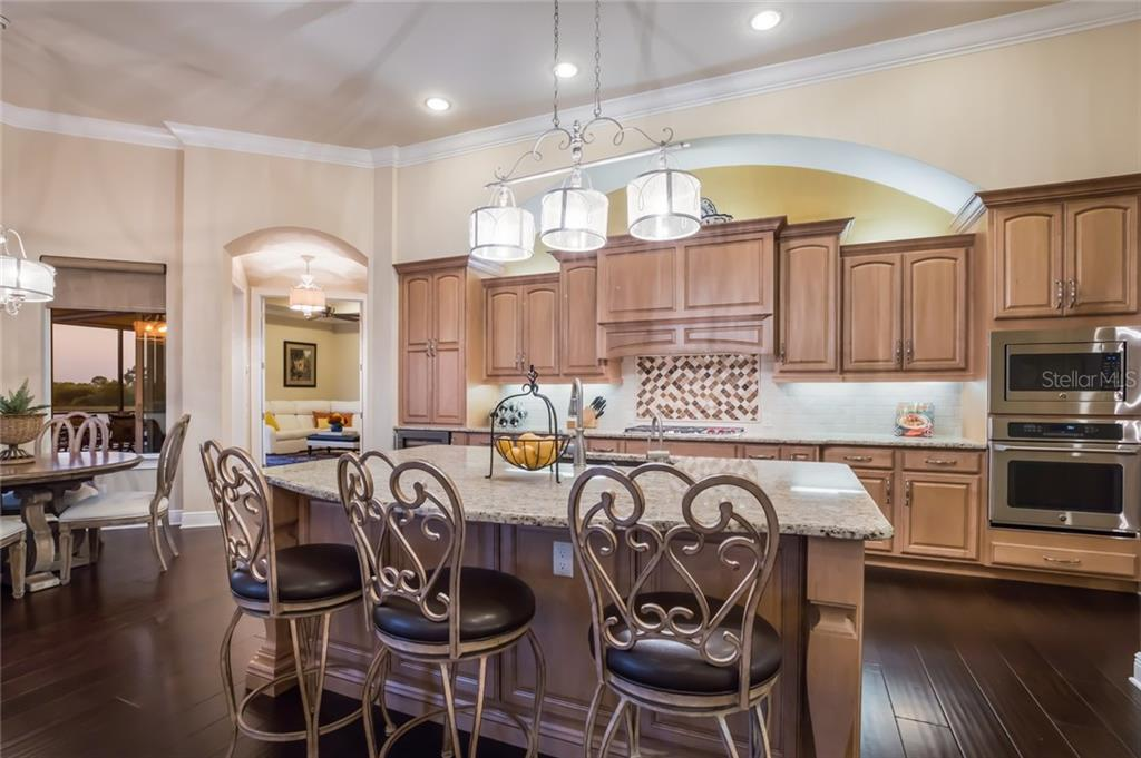 Off the kitchen is the breakfast nook. - Single Family Home for sale at 19432 Newlane Pl, Bradenton, FL 34202 - MLS Number is A4432094