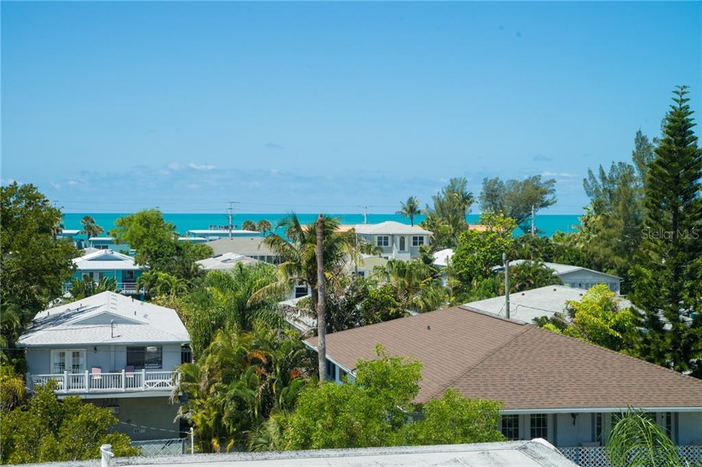 See the Gulf from the Roof Top Deck - Single Family Home for sale at 2405 Avenue A, Bradenton Beach, FL 34217 - MLS Number is A4433128