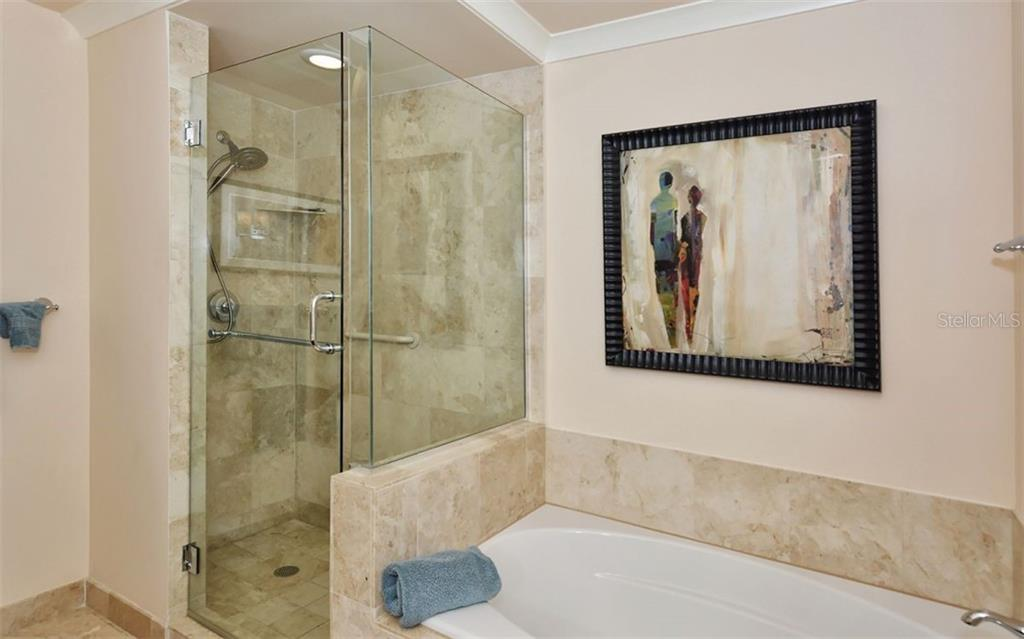 Master bath with separate shower stall and soaking tub - Condo for sale at 1350 Main St #1500, Sarasota, FL 34236 - MLS Number is A4433444