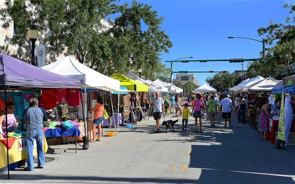 One of the frequent festivals downtown; there's also a weekly farmer's market - Condo for sale at 1350 Main St #1500, Sarasota, FL 34236 - MLS Number is A4433444