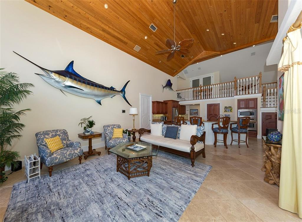 Family room with Select Cypress 1 x 6 ceilings - Single Family Home for sale at 1361 Bayshore Dr, Englewood, FL 34223 - MLS Number is A4433943