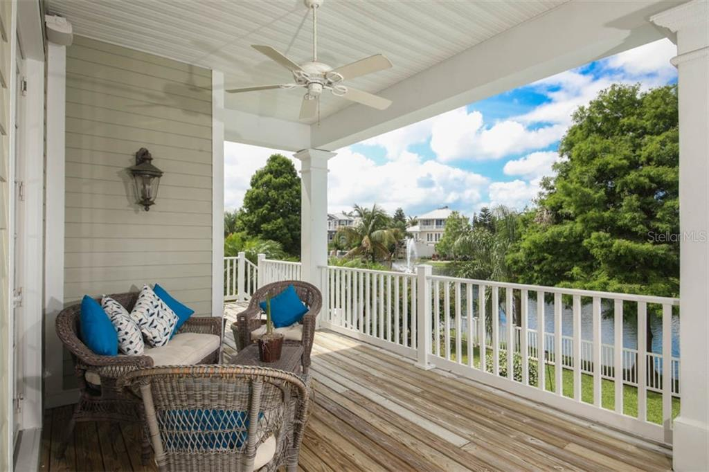 Back porch with beautiful pond views. - Single Family Home for sale at 7153 Hawks Harbor Cir, Bradenton, FL 34207 - MLS Number is A4434661