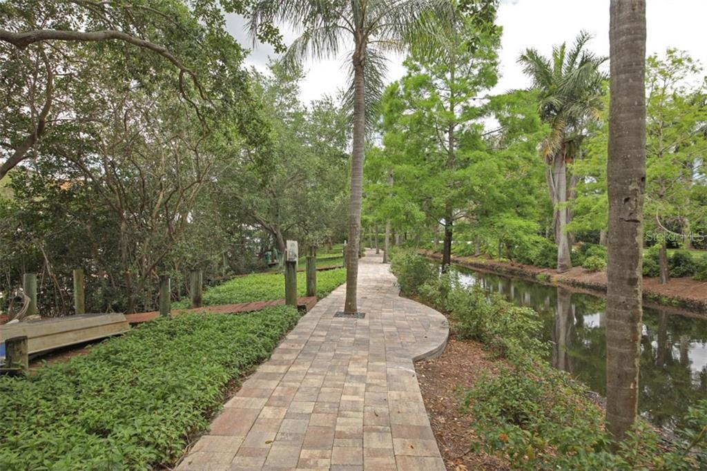 Beautiful path leading to the neighborhood docks. - Single Family Home for sale at 7153 Hawks Harbor Cir, Bradenton, FL 34207 - MLS Number is A4434661
