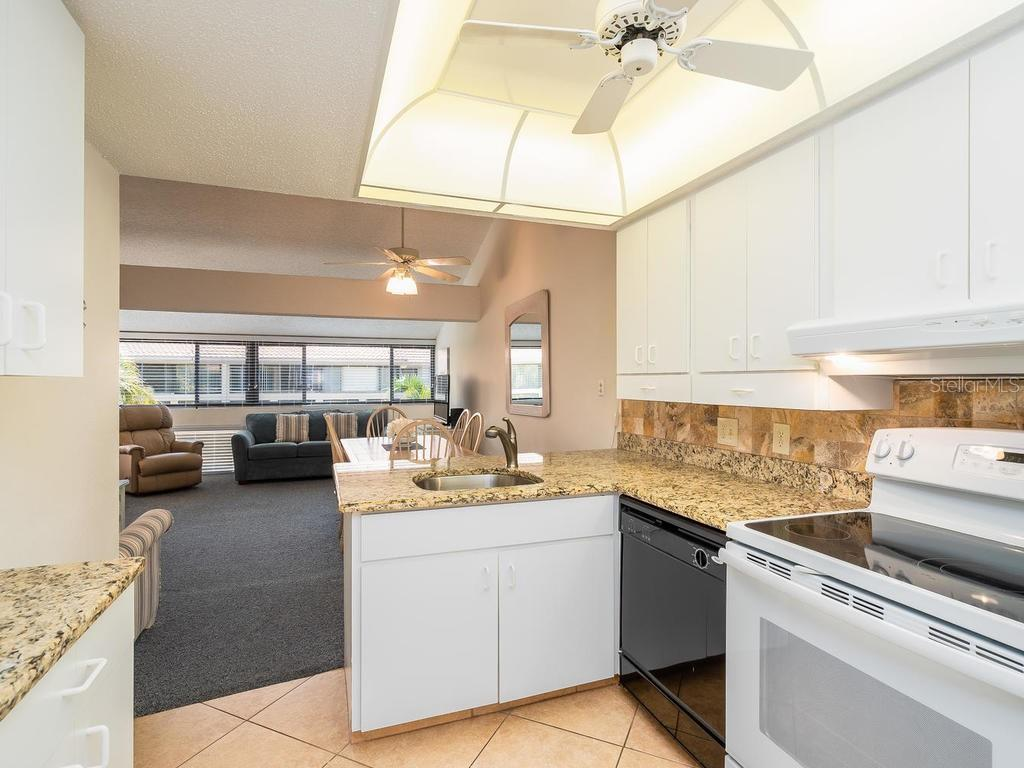 Kitchen overlooking the Family/Dining Room. - Condo for sale at 4621 Gulf Of Mexico Dr #14d, Longboat Key, FL 34228 - MLS Number is A4435849
