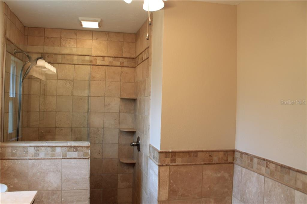 A great space for a make up vanity across from the sink in this master bath. - Single Family Home for sale at 4803 Glenbrooke Dr, Sarasota, FL 34243 - MLS Number is A4435920