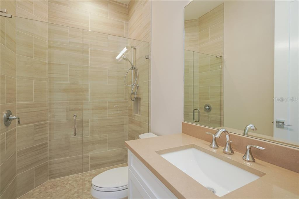 Full bathroom/powder room with beautiful details - Single Family Home for sale at 1555 Sandpiper Ln, Sarasota, FL 34239 - MLS Number is A4436047